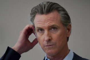 California Gov. Gavin Newsom listens to questions while speaking at a news conference at Ruby Bridges Elementary School in Alameda, Calif., Tuesday, March 16, 2021. Former Republican congressman Doug Ose announced Tuesday he's entering the recall election aimed at ousting California Gov. Gavin Newsom, a day after the Democratic governor began raising money to defend his seat in a likely election this year. (AP Photo/Jeff Chiu)