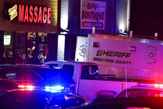Authorities investigate a fatal shooting at a massage parlor, late Tuesday, March 16, 2021, in Woodstock, Ga. Officials say 21-year-old Robert Aaron Long, of Woodstock, Georgia, has been captured hours after multiple people were killed in shootings at three Atlanta-area massage parlors. (AP Photo/Mike Stewart)