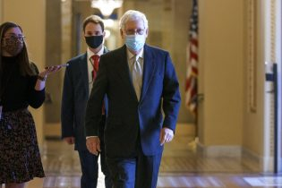 Senate Minority Leader Mitch McConnell, R-Ky., heads to the chamber as the Senate holds the final vote to confirm Xavier Becerra, President Joe Biden's pick to be secretary of Health and Human Services, at the Capitol in Washington, Thursday, March 18, 2021. (AP Photo/J. Scott Applewhite)