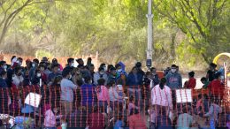 Migrants are seen in custody at a U.S. Customs and Border Protection processing area under the Anzalduas International Bridge, Friday, March 19, 2021, in Mission, Texas. A surge of migrants on the Southwest border has the Biden administration on the defensive. The head of Homeland Security acknowledged the severity of the problem Tuesday but insisted it's under control and said he won't revive a Trump-era practice of immediately expelling teens and children. An official says U.S. authorities encountered nearly double the number children traveling alone across the Mexican border in one day this week than on an average day last month. (AP Photo/Julio Cortez)
