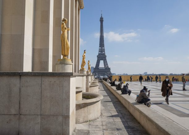 People walk near the Eiffel Tower in Paris, France, Saturday, March 20, 2021. The French government has backed off from ordering a tough lockdown for Paris and several other regions despite an increasingly alarming situation at hospitals with a rise in the number of COVID-19 patients. (AP Photo/Rafael Yaghobzadeh)