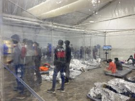 This March 20, 2021 photo provided by the Office of Congressman Henry Cuellar, (TX-28), shows detainees in a Customs and Border Protection (CBP) temporary overflow facility in Donna, Texas. President Joe Biden's administration faces mounting criticism for refusing to allow outside observers into facilities where it is detaining thousands of immigrant children. (Photo courtesy of the Office of Congressman Henry Cuellar via AP)