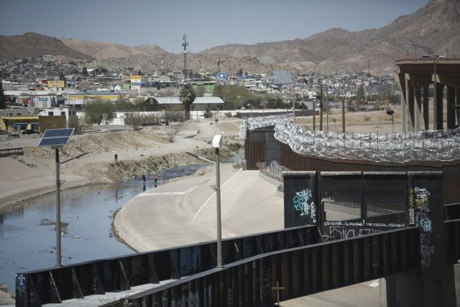 People cross the Rio Grande from Ciudad Juarez, Mexico into El Paso, Texas, Tuesday, March 23, 2021. Mexico announced that U.S. advisers on border and immigration issues will meet with Mexican officials on Tuesday to discuss migration and development in Central America, as a surge of migrants has hit the U.S. southern border. (AP Photo/Christian Chavez)