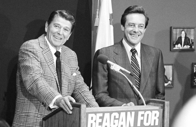 FILE - In this July 13, 1980, file photo, Republican presidential hopeful Ronald Reagan, left smiles with Bill Brock, right, Republican National Chairman, during a news conference in Los Angeles. Brock, a former Tennessee senator and Republican chairman who rebuilt the party after the Watergate scandal, died Thursday, March 25, 2021, family friend Tom Griscom said. He was 90. (AP Photo/File)