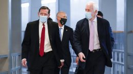 Sen.John Barrasso, R-Wyo., and Sen. John Cornyn, R-Texas, head to the chamber for votes, at the Capitol in Washington, Thursday, March 25, 2021. They and other Senate Republicans will be part of a delegation visiting the Texas-Mexico border in response to the immigration crisis there. (AP Photo/J. Scott Applewhite)