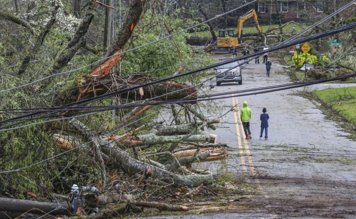 Storms that rolled through North Georgia late Thursday into Friday, March 26, 2021, left a path of destruction. Most of metro Atlanta was spared from major damage, but Bartow and Polk counties ― in northwest Georgia ― and Coweta County south of Atlanta took the brunt of the impact. Coweta firefighters and police officers worked in the dark to rescue people trapped in their homes and clear roads after a powerful storm slammed the area early Friday. (John Spink /Atlanta Journal-Constitution via AP)