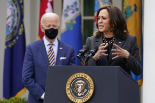 FILE - In this March 12, 2021, file photo President Joe Biden listens as Vice President Kamala Harris speaks about the American Rescue Plan, a coronavirus relief package, in the Rose Garden of the White House in Washington. (AP Photo/Alex Brandon, File)