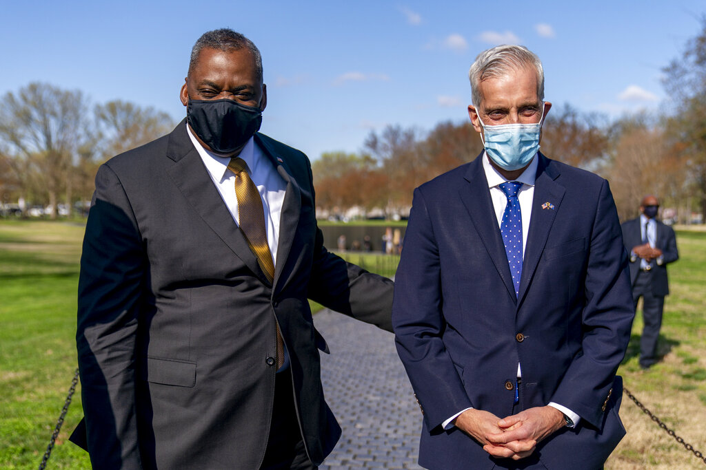 Secretary of Defense Lloyd Austin and Veterans Affairs Secretary Denis McDonough pose for a photograph before laying a wreath at the Vietnam Veterans Memorial, Monday, March 29, 2021, in Washington. (AP Photo/Andrew Harnik)