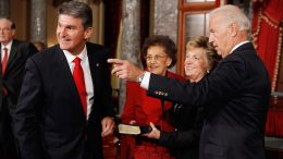 WASHINGTON - NOVEMBER 15: U.S. Sen. Joe Manchin (D-WV) (L) looks in the direction that Vice President Joe Biden (R) points as Manchin's wife Gayle Manchin (2nd R) holds a Bible and his mother, Mary Manchin, looks on before Manchin's ceremonial swearing in inside the Old Senate Chamber at the U.S. Capitol November 15, 2010 in Washington, DC. Manchin, a former governor of West Virginia, ran for the senate seat left open by the death of U.S. Sen. Robert Byrd (D- WV). (Photo by Chip Somodevilla/Getty Images)