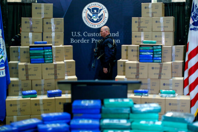 A police officer walks near cocaine seized from a cargo ship at a Philadelphia port during a news conference at the U.S. Custom House on June 21, 2019 in Philadelphia, Pennsylvania. At least 17.5 tons of cocaine with more than $1 billion in street value was seized at the Philadelphia seaport, being the largest cocaine seizure in the 230 year history of U.S Customs and Border protection. (Photo by Eduardo Munoz Alvarez/Getty Images)