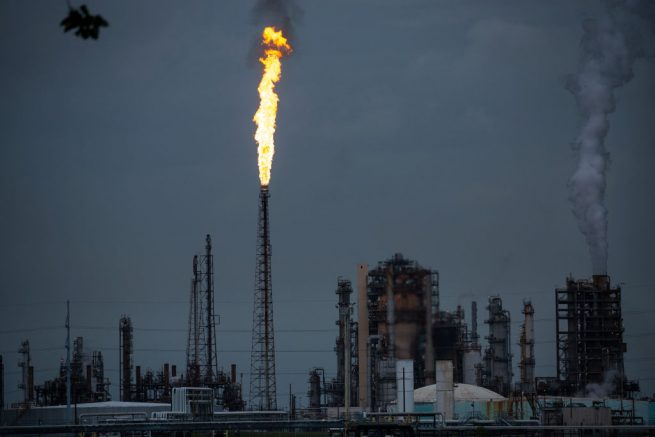 NORCO, LA - AUGUST 21: A gas flare from the Shell Chemical LP petroleum refinery illuminates the sky on August 21, 2019 in Norco, Louisiana. Located about 10 miles up the Mississippi River from New Orleans, the plant agreed to install $10 million in pollution monitoring and control equipment in 2018 to settle allegations that flares used to burn off emissions were operating in violation of federal law (the Clean Air Act). Many of the coastal parishes in Louisiana have a long and ongoing history in oil and gas production, which is often at odds with concerns of environmentalists. (Photo by Drew Angerer/Getty Images)