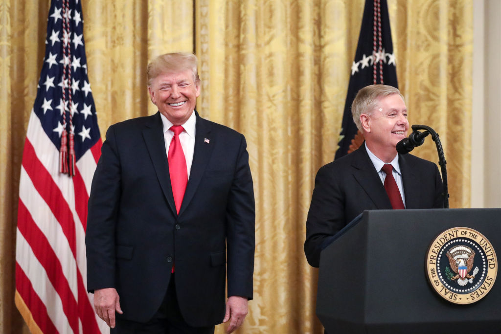 WASHINGTON, DC - NOVEMBER 6: (L-R) President Donald Trump looks on as Sen. Lindsey Graham (R-SC) speaks during an event about judicial confirmations in the East Room of the White House on November 6, 2019 in Washington, DC. More than 150 of the president's federal judicial nominees have been confirmed by the Republican-controlled Senate. (Photo by Drew Angerer/Getty Images)