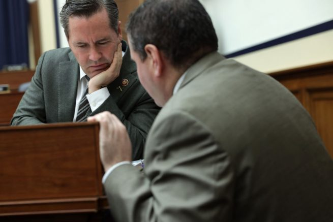 """WASHINGTON, DC - DECEMBER 11: U.S. Rep. Michael Waltz (R-FL) listens to an aide during a hearing before the House Armed Services Committee December 11, 2019 on Capitol Hill in Washington, DC. The committee held a hearing on """"U.S. Policy in Syria and the Broader Region."""" (Photo by Alex Wong/Getty Images)"""