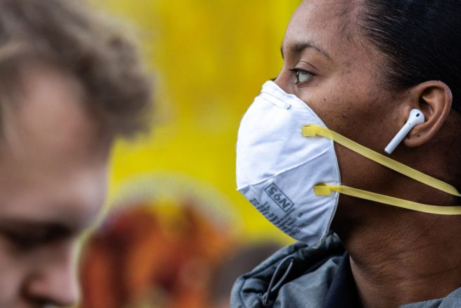 NEW YORK, NY - MARCH 09: A woman wearing a protective mask is seen in Union Square on March 9, 2020 in New York City. There are now 20 confirmed coronavirus cases in the city including a 7-year-old girl in the Bronx. (Photo by Jeenah Moon/Getty Images)