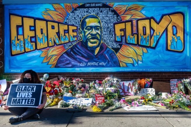 TOPSHOT - Flowers, signs and balloons are left near a makeshift memorial to George Floyd near the spot where he died while in custody of the Minneapolis police, on May 29, 2020 in Minneapolis, Minnesota. - Demonstrations are being held across the US after George Floyd died in police custody on May 25. (Photo by Kerem Yucel / AFP) (Photo by KEREM YUCEL/AFP via Getty Images)