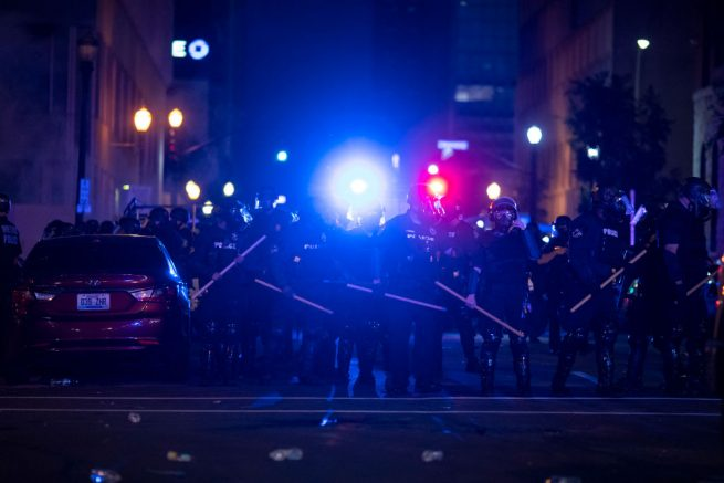 LOUISVILLE, KY - MAY 29:  Police in riot gear stand in formation during protests on May 29, 2020 in Louisville, Kentucky. Protests have erupted after recent police-related incidents resulting in the deaths of African-Americans Breonna Taylor in Louisville and George Floyd in Minneapolis, Minnesota. (Photo by Brett Carlsen/Getty Images)
