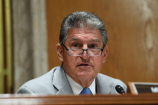 WASHINGTON, DC - JUNE 16: Sen. Joe Manchin (D-WV) questions Ajit Pai, Chairman of the Federal Communications Commission, during his testimony before an oversight hearing to examine the Federal Communications Commission spectrum auctions program for fiscal year 2021 on June 16, 2020 in Washington, DC. The hearing was held by the Senate Appropriations Subcommittee on Financial Services and General Government. (Photo by Toni Sandys-Pool/Getty Images)