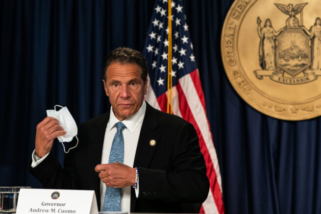 NEW YORK, NY - JULY 23: New York Gov. Andrew Cuomo takes off a protective mask during the daily media briefing at the Office of the Governor of the State of New York on July 23, 2020 in New York City. The Governor said the state liquor authority has suspended 27 bar and restaurant alcohol licenses for violations of social distancing rules as public officials try to keep the coronavirus outbreak under control. (Photo by Jeenah Moon/Getty Images)