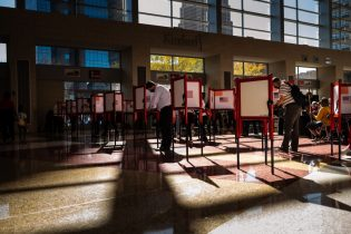LOUISVILLE, KY - OCTOBER 13: Voters fill out their ballots at the KFC YUM! Center on October 13, 2020 in Louisville, Kentucky. Tuesday marked the first day of early in-person voting in Kentucky, which lasts through November 2. (Photo by Jon Cherry/Getty Images)