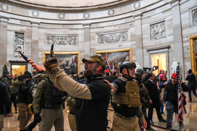 TOPSHOT - Supporters of US President Donald Trump enter the US Capitol's Rotunda on January 6, 2021, in Washington, DC. - Demonstrators breeched security and entered the Capitol as Congress debated the a 2020 presidential election Electoral Vote Certification. (Photo by Saul LOEB / AFP) (Photo by SAUL LOEB/AFP via Getty Images)