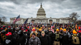 WASHINGTON, DC - JANUARY 06: protesters gather in front of the U.S. Capitol Building on January 6, 2021 in Washington, DC. A pro-Trump mob stormed the Capitol, breaking windows and clashing with police officers. Trump supporters gathered in the nation's capital today to protest the ratification of President-elect Joe Biden's Electoral College victory over President Trump in the 2020 election. (Photo by Jon Cherry/Getty Images)