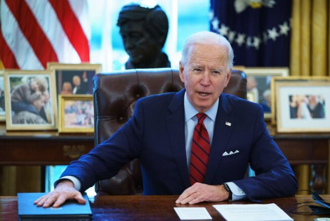 TOPSHOT - Joe Biden speaks before signing executive orders on health care, in the Oval Office of the White House in Washington, DC, on January 28, 2021. - The orders include reopening enrollment in the federal Affordable Care Act. (Photo by MANDEL NGAN / AFP) (Photo by MANDEL NGAN/AFP via Getty Images)