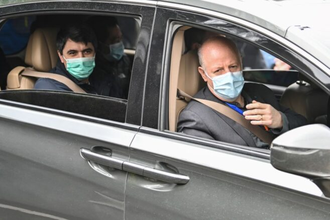 Peter Daszak (R), Vladimir G. Dedkov( L) and other members of the World Health Organization (WHO) team investigating the origins of the Covid-19 coronavirus, leave the Hubei Center for animal disease control and prevention in Wuhan, China's central Hubei province on February 2, 2021. (Photo by Hector RETAMAL / AFP) (Photo by HECTOR RETAMAL/AFP via Getty Images)