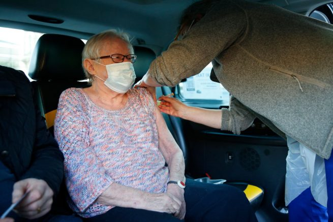 LONDON, ENGLAND - FEBRUARY 28: Jane Anne Short, 75, receives her first dose of the AstraZeneca vaccine from Dr Tamara Joffe inside a Vaxi Taxi in Kilburn on February 28, 2021 in London, England. The programme aims to encourage covid-19 vaccine uptake by ferrying patients to vaccination appointments, as well as taking supplies from hospitals to pop-up clinics. (Photo by Hollie Adams/Getty Images)