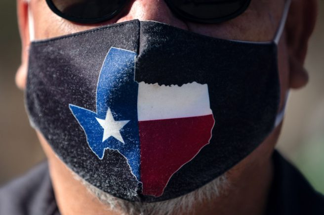 AUSTIN, TX - MARCH 03: San Jose Hotel engineering manager Rocky Ontiveros, 60, wears a Texas mask on March 3, 2021 in Austin, Texas. Gov. Greg Abbott announced a new executive order that will end the statewide mask mandate and allow businesses to reopen at 100% capacity on March 10, 2021.(Photo by Montinique Monroe/Getty Images)