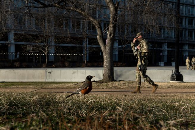 A member of the National Guard walks a security perimeter surrounding the US Capitol building on Capitol Hill on March 4, 2021, in Washington, DC. - The grounds of the US Capitol were ringed with boosted security Thursday after officials warned of an attack plot by QAnon conspiracists, two months after backers of ex-president Donald Trump stormed the Capitol building. (Photo by Brendan Smialowski / AFP) (Photo by BRENDAN SMIALOWSKI/AFP via Getty Images)