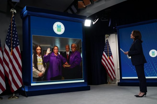 US Vice President Kamala Harris presides over the ceremonial swearing-in for Housing and Urban Development Secretary Marcia Fudge (on screen C) in the South Court Auditorium, next to the White House, in Washington, DC on March 10, 2021. (Photo by MANDEL NGAN / AFP) (Photo by MANDEL NGAN/AFP via Getty Images)