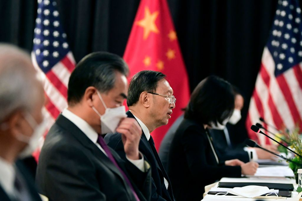 "TOPSHOT - The Chinese delegation led by Yang Jiechi (C), director of the Central Foreign Affairs Commission Office and Wang Yi (2nd L), China's Foreign Minister, speak with their US counterparts at the opening session of US-China talks at the Captain Cook Hotel in Anchorage, Alaska on March 18, 2021. - China's actions ""threaten the rules-based order that maintains global stability,"" US Secretary of State Antony Blinken said Thursday at the opening of a two-day meeting with Chinese counterparts in Alaska. (Photo by Frederic J. BROWN / POOL / AFP) (Photo by FREDERIC J. BROWN/POOL/AFP via Getty Images)"