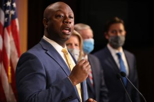 WASHINGTON, DC - JUNE 17: Sen. Tim Scott (R-SC) is joined by fellow Republican lawmakers for a news conference to unveil the GOP's legislation to address racial disparities in law enforcement at the U.S. Capitol June 17, 2020 in Washington, DC. Scott, the Senate's lone black Republican, lead the effort to write the Just and Unifying Solutions to Invigorate Communities Everywhere (JUSTICE) Act, which discourages the use of chokeholds, requires police departments to release more information on use of force and no-knock warrants, and encourages body cameras and better training. (Photo by Chip Somodevilla/Getty Images)