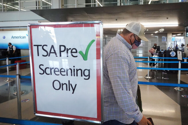 CHICAGO, ILLINOIS - OCTOBER 19: A passenger enters a Transportation Security Administration (TSA) checkpoint at O'Hare International Airport on October 19, 2020 in Chicago, Illinois. Yesterday the TSA reported that it had screened over 1 million passengers, representing the highest number of passengers screened at TSA checkpoints since March 17, 2020. During the week ending October 18, TSA screened 6.1 million passengers nationwide, the highest total since the start of the COVID-19 pandemic. (Photo by Scott Olson/Getty Images)