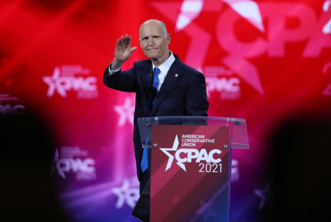 ORLANDO, FLORIDA - FEBRUARY 26: Sen. Rick Scott (R-FL) addresses the Conservative Political Action Conference being held in the Hyatt Regency on February 26, 2021 in Orlando, Florida. Begun in 1974, CPAC brings together conservative organizations, activists, and world leaders to discuss issues important to them. (Photo by Joe Raedle/Getty Images)
