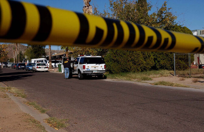 PHOENIX, AZ - DECEMBER 10: Crime tape is photographed at a crime scene at an East Mesa home December 10, 2002 in Phoenix, Arizona. Four adults and one child were found shot to death in the home and a suspect is in custody. (Photo by Jill Torrance/Getty Images)