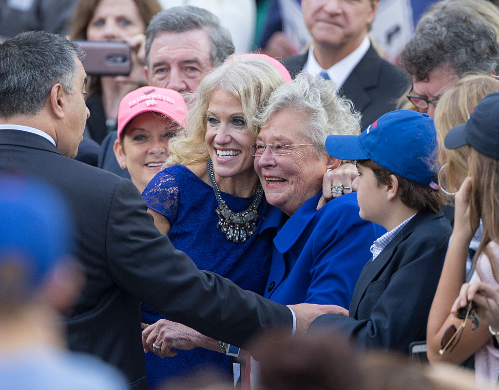 MOBILE, AL - DECEMBER 17: President-elect Donal Trump's campaign manager Kellyanne Conway, left, poses for photos with Alabama Lieutenant Governor Kay Ivey during a thank you rally in Ladd-Peebles Stadium on December 17, 2016 in Mobile, Alabama. President-elect Trump has been visiting several states that he won, to thank people for their support during the U.S. election. (Photo by Mark Wallheiser/Getty Images)