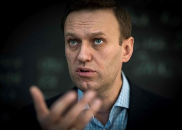 "TOPSHOT - Russian opposition leader Alexei Navalny speaks during an interview with AFP at the office of his Anti-corruption Foundation (FBK) in Moscow on January 16, 2018. - The Kremlin's top critic Alexei Navalny has slammed Russia's March presidential election, in which he is barred from running, as a sham meant to ""re-appoint"" Vladimir Putin on his way to becoming ""emperor for life"". (Photo by Mladen ANTONOV / AFP) (Photo by MLADEN ANTONOV/AFP via Getty Images)"