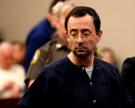 """Former Michigan State University and USA Gymnastics doctor Larry Nassar addresses the court during the sentencing phase in Ingham County Circuit Court on January 24, 2018 in Lansing, Michigan.  Disgraced former USA Gymnastics doctor Larry Nassar was sentenced to 40 to 175 years in prison on Wednesday for sexually abusing scores of young girls under the guise of medical treatment. """"I've just signed your death warrant,"""" Judge Rosemarie Aquilina said as she handed down the sentence after a week of gut-wrenching testimony by over 150 of Nassar's victims.  / AFP PHOTO / JEFF KOWALSKY        (Photo credit should read JEFF KOWALSKY/AFP via Getty Images)"""