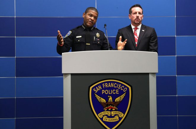 SAN FRANCISCO, CA - APRIL 06: San Francisco police chief William Scott (L) speaks during a press conference with special agent in charge of homeland security investigations Ryan Spradlin (R) at San Francisco police headquarters on April 6, 2018 in San Francisco, California. The San Francisco police and Department of Homeland Security Investigations announced the arrests in six homicide cases that took place between 2006 and 2013. Ten alleged members of the Surenos gang were charged with murder and related crimes. (Photo by Justin Sullivan/Getty Images)