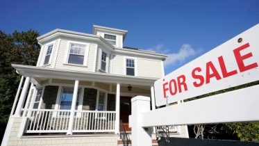 FILE - A for sale sign stands in front of a house, Tuesday, Oct. 6, 2020, in Westwood, Mass. (AP Photo/Steven Senne)