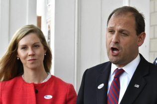 Rep. Andy Barr, R-Ky., right, and his wife Carol speak with reporters outside his polling place in Lexington, Ky., Tuesday, Nov. 6, 2018. (AP Photo/Timothy D. Easley)