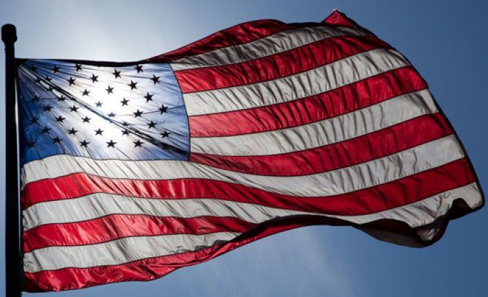 File - An American flag is pictured waving in the wind. (AP Photo)