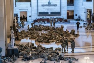 Hundreds of National Guard troops hold inside the Capitol Visitor's Center to reinforce security at the Capitol in Washington, Wednesday, Jan. 13, 2021. The House of Representatives is pursuing an article of impeachment against President Donald Trump for his role in inciting an angry mob to storm the Capitol last week. (AP Photo/J. Scott Applewhite