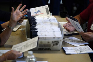 Election workers in Chester County, Pa., process mail-in and absentee ballots for the 2020 general election on Nov. 4. | Matt Slocum/AP Photo