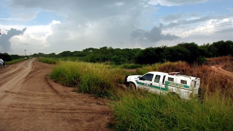 A U.S. Border Patrol vehicle drives upon the river levee, Tuesday, Aug. 8, 2006 near the Rio Grande north of Brownsville, Texas. (AP Photo/Brad Doherty)