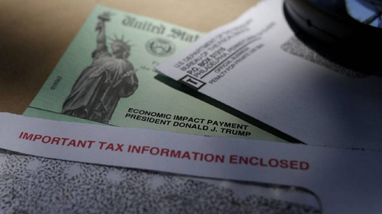 FILE - In this April file photo, President Donald Trump's name is seen on a stimulus check issued by the IRS. (AP Photo/Eric Gay, File)