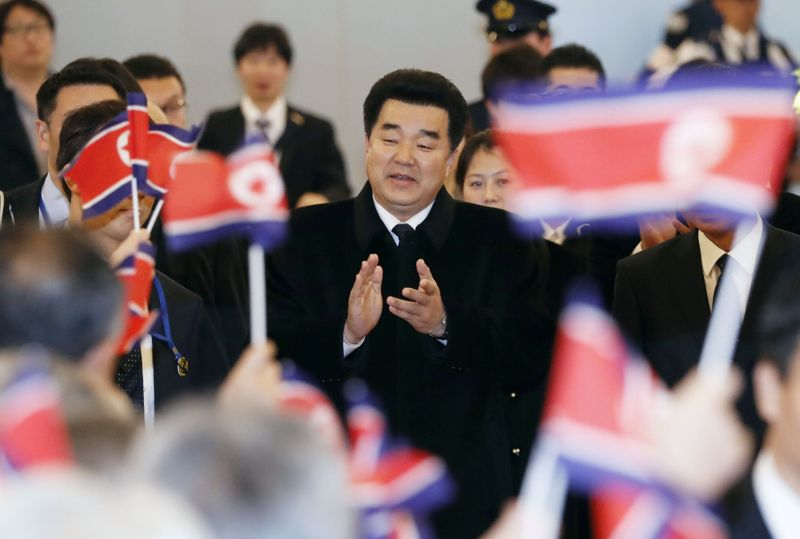 FILE PHOTO: Kim Il Guk, North Korea's sports minister and the president of the Olympic Committee of North Korea is greeted by North Korean residents in Japan upon his arrival at Tokyo's Haneda airport