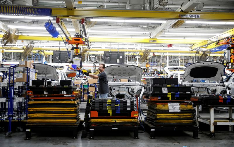A worker builds a 2020 Ford Explorer car at Ford's Chicago Assembly Plant in Chicago