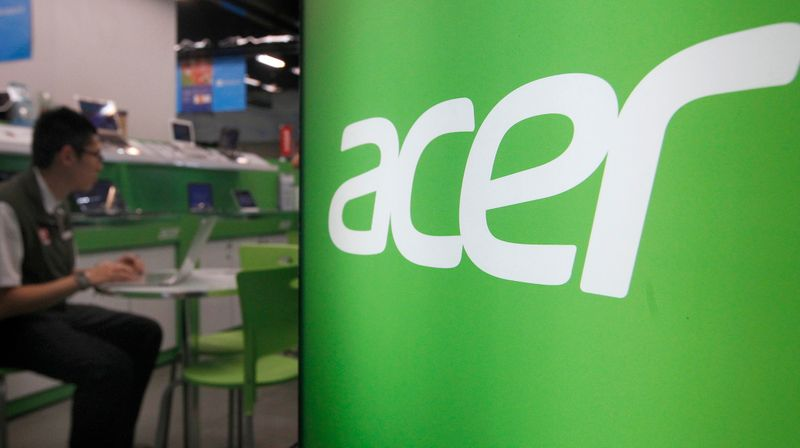 FILE PHOTO: A shop attendant sits in an Acer booth in a computer mall in Taipei